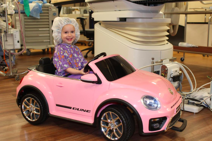 pediatric patients drive toy cars